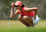 CHON BURI, THAILAND - FEBRUARY 20:  Michelle Wie of USA lines up a putt on the 4th hole during day four of the LPGA Thailand at Siam Country Club on February 20, 2011 in Chon Buri, Thailand. Photo by Victor Fraile / The Power of Sport Images
