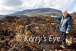 Ranger Padraig O'Sullivan assess the fire damage to Killarney National Park on Tuesday
