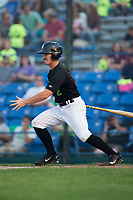 J.J. Muno (2) of the Great Falls Voyagers follows through on his swing against the Helena Brewers at Centene Stadium on August 18, 2017 in Helena, Montana.  The Voyagers defeated the Brewers 10-7.  (Brian Westerholt/Four Seam Images)