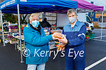 Audrey Clifford helping John Dalton from Listellick at the Farmers Market on Saturday morning.