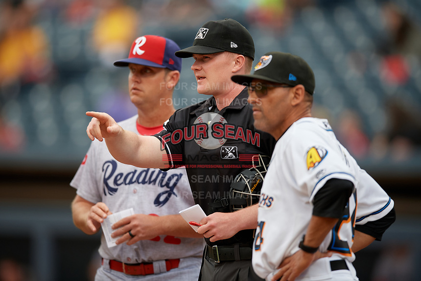 Umpire Thomas Roche during the lineup exchange with Rouglas Odor (right) and Sean Williams (left) before an Eastern League game between the Reading Fightin Phils and Akron RubberDucks on June 4, 2019 at Canal Park in Akron, Ohio.  Akron defeated Reading 8-5.  (Mike Janes/Four Seam Images)