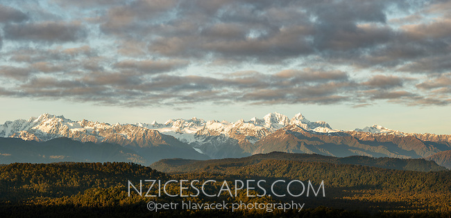 Sunrise over Southern Alps with Aoraki Mount Cook and Mount Tasman on skyline, Franz Josef Glacier in centre, Westland Tai Poutini National Park, UNESCO World Heritage Area, South Westland, New Zealand, NZ