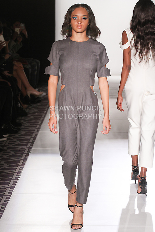 Model walks runway in an outfit from the Espion Atelier Autumn Winter 2015 collection by Deidre Jeffries, at Fashion Gallery NYFW Fall 2015.