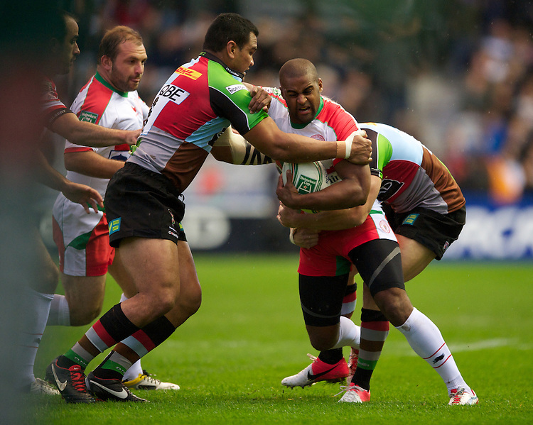 Aled Brew of Biarritz Olympique is tackled by Maurie Fa'asavalu (left) and Tom Williams of Harlequins during the Heineken Cup match between Harlequins and Biarritz Olympique Pays Basque at the Twickenham Stoop on Saturday 13th October 2012 (Photo by Rob Munro)