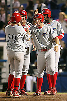 April 10th 2009:  First baseman Matthew Rizzotti (left), Designated Hitter Tim Kennelly (right), and Domonic Brown (back) of the Clearwater Threshers, Florida State League Class-A affiliate of the Philadelphia Phillies, greet Catcher Joel Naughton after hitting a grand slam home run in the top of the 7th inning during a game at Dunedin Stadium in Dunedin, FL.  Photo by:  Mike Janes/Four Seam Images