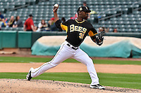 Yoslan Herrera (31) of the Salt Lake Bees delivers a pitch to the plate against the Memphis Redbirds at Smith's Ballpark on June 18, 2014 in Salt Lake City, Utah.  (Stephen Smith/Four Seam Images)