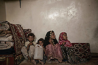 Wednesday 15 July, 2015: The children of Tawfiq Hussain Djaber (not pictured) sit inside a roomhouse in an abandoned salafist madrasa (university) where 7000 students used to live and learn in Dammaj village. The madrasa is now used as temporary shelter for the displaced families from the heavy fighting and bombarments in Sa'dah governorate in the northern province of Sa'dah, the stronghold of the Houthi's movement in Yemen. (Photo/Narciso Contreras)