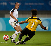 Karina LeBlanc, Angela Hucles. The USWNT defeated Canada in extra time, 2-1, during the 2008 Beijing Olympics in Shanghai, China.