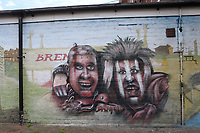 Graffiti showing a couple of Brentford supporters on a wall near the ground during Brentford vs Barnsley, Sky Bet EFL Championship Football at Griffin Park on 22nd July 2020