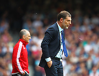 Slaven Bilic manager of West Ham United unhappy at first half  during the Barclays Premier League match between West Ham United and Swansea City  played at Boleyn Ground , London on 7th May 2016