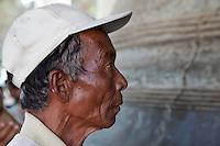 Myanmar, Burma.  Mingun, near Mandalay.  Burmese Man Looking at the Mingun Bell, largest hung uncracked bell in the world.