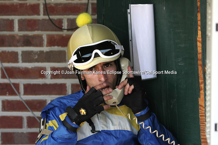 July 12, 2014: Avarice wins the Fort Delaware Stakes after first-place finisher Picko's Pride is disqualified to last for interference at Delaware Park in Stanton Delaware.  Alex Cintron, Picko's Pride's jockey, speaks to stewards while awaiting their decision. Avarice's trainer is John Robb; owners are John Robb and Herman Braude. ©Joan Fairman Kanes/ESW/CSMJuly 12, 2014: