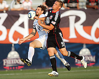 Danny Allsopp #9 of D.C. United battles against Dustin Bixler #3 of the Harrisburg City Islanders during a US Open Cup match at the Maryland Soccerplex on July 21 2010, in Boyds, Maryland. United won 2-0.