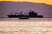 Pictured: Type 702 Berlin class replenishment ship Bonn in the background next to a Greek Coast Guard vessel off the coast of Lesvos Wednesday 09 March 2016<br />Re: Migrants have been landing on beaches near the area of the airport at the area of Mytilene in Lesvos island, Greece