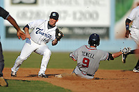 Asheville Tourists second baseman Matt Wessinger #16 fields the throw as Tyler Tewell #9 slides in safely during game one of a double header against the Rome Braves  at McCormick Field on June 4, 2013 in Asheville, North Carolina. The Braves won the game 5-3. (Tony Farlow/Four Seam Images)