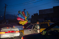 Balloon seller at night in Kabul 5-1-14