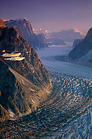 Cessna 185 Float Plane flies up the Ruth Gorge in the Alaska Range Summer Aerial