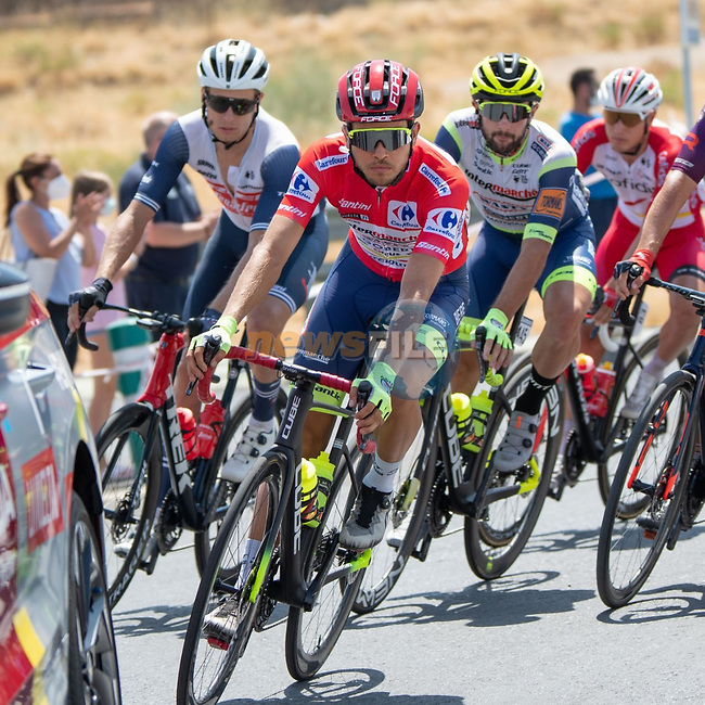 The peloton with race leader Odd Christian Eiking (NOR) Intermarché-Wanty-Gobert Matériaux during Stage 11 of La Vuelta d'Espana 2021, running 133.6km from Antequera to Valdepeñas de Jaén, Spain. 25th August 2021.     <br /> Picture: Cxcling | Cyclefile<br /> <br /> All photos usage must carry mandatory copyright credit (© Cyclefile | Cxcling)