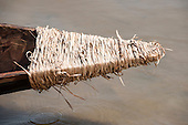The palm-rope bound prow of a competing canoe drips into the water before the canoe race at the International Indigenous Games, in the city of Palmas, Tocantins State, Brazil. Photo © Sue Cunningham, pictures@scphotographic.com 29th October 2015