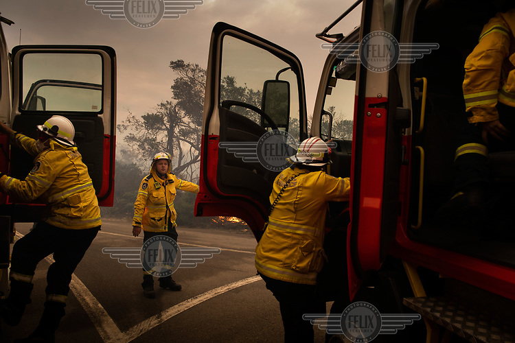 Fire service personnel prepare to tackle a serious fire that burnt much of Sydney's North Head. The fire spread after a NSW National Parks hazard reduction burn jumped containment lines and quickly got out of control forcing the evacuation of nearby residents and the destruction of 90 hectares of bushland. Increasingly, as science continues to inform us that climate change is having an enormous impact on the frequency and intensity of weather related events, the windows for optimal hazard reduction burn conditions are becoming smaller.