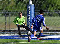 NWA Democrat-Gazette/CHARLIE KAIJO Rogers High School Paco Jimenez (10) scores on Bentonville High School Evan Shanks (1) during a soccer game, Friday, April 26, 2019 at  Whitey Smith Stadium at Rogers High School in Rogers.