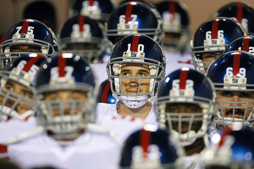 New York Giants quarterback Eli Manning(#10, center) just before kickoff as the Jacksonville Jaguars host the NY Giants in NFL Monday Night Football action at Alltel Stadium. JACKSONVILLE, FL  11/20/06  9:29:19 PM