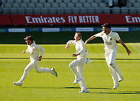 30th May 2021; Emirates Old Trafford, Manchester, Lancashire, England; County Championship Cricket, Lancashire versus Yorkshire, Day 4; Elation for Josh Bohannon, Matt Parkinson and Tom Bailey of Lancashire as the last Yorkshire wicket falls for 271 and the Red Rose claims victory by an innings and 79 runs
