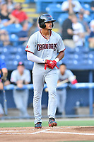 Hickory Crawdads center fielder Bubba Thompson (25) walks to first base after being hit by a pitch during a game against the Asheville Tourists at McCormick Field on August 16, 2018 in Asheville, North Carolina. The Crawdads defeated the Tourists 3-0. (Tony Farlow/Four Seam Images)