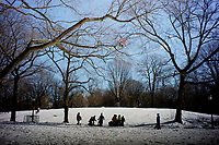 NEW YORK, NEW YORK - FEBRUARY 21: Children walk in Central Park covered by snow and ice  on February 21, 2021 in New York City. The big apple waits this monday the last snowfall before a midweek warm up.  (Photo by John Smith/VIEWpress via Getty Images)