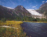 The Boyabreen Glacier falling steeply between two rocky peaks, and the Boyabreen River, Jostedal region, Norwa