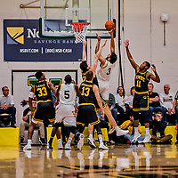 16 March 2019: University of Vermont Catamount Forward Anthony Lamb, a Junior from Toronto, Ontario, lays one up in the the first half against the UMBC Retrievers in the America East Championship Game at Patrick Gymnasium in Burlington, Vermont. Lamb was named the Most Outstanding Player for the second time in his career with a game-high 28 points and nine rebounds as the Catamounts defeated the Retrievers 66-49 to avenge their loss against the same team in last years' Championship Game. Mandatory Credit: Ed Wolfstein Photo *** RAW (NEF) Image File Available ***