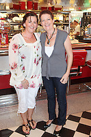 """NO REPRO FEE. 26/5/2011. NEW EDDIE ROCKET'S SHAKE SHOP. Valerie Scully and Mags Tierney are pictured in the new Eddie Rocket's Shake Shop. The design seeks to recall the vintage milkshake bars from 1950's America and re-imagine them for the 21st century. The new look aims to appeal to both young and old with a quirky and bold colour scheme and a concept of make-your-own milkshakes, based on the tag line """"You make it...We shake it!"""". Eddie Rocket's City Diner in the Stillorgan Shopping Centre in south Dublin has re-opened after an exciting re-vamp and the addition of a Shake Shop. Ten new jobs have been created with the Diner's re-launch bringing the total working in Eddie Rocket's Stillorgan to 30. Picture James Horan/Collins Photos"""