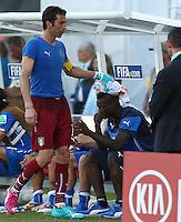 Italy goalkeeper Gianluigi Buffon consoles an emotional Mario Balotelli at full time