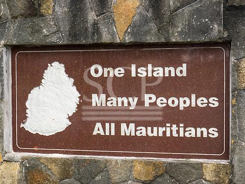 "Ganga Talao, Grand Bassin, Savanne, Mauritius. Sign on a wall:;""One Island Many Peoples All Mauritians""."