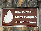 "Ganga Talao, Grand Bassin, Savanne, Mauritius. Sign on a wall:;""One Island Many Peoples All Mauritians""."