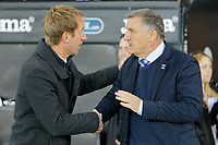 (L-R) Swansea City manager Graham Potter greets Blackburn Rovers manager Tony Mowbray during the Sky Bet Championship match between Swansea City and Blackburn Rovers at the Liberty Stadium, Swansea, Wales, UK. Tuesday 23 October 2018