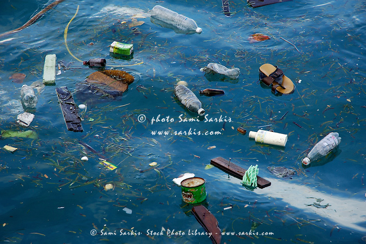 Plastic bottles and rubbish floating in the sea, Maldives.