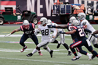 27th September 2020, Foxborough, New England, USA;  Las Vegas Raiders running back Josh Jacobs (28) breaks into the backfield during the game between the New England Patriots and the Las Vegas Raiders
