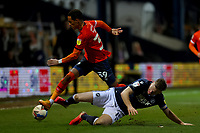 23rd February 2021; Kenilworth Road, Luton, Bedfordshire, England; English Football League Championship Football, Luton Town versus Millwall; Alex Pearce of Millwall challenges Thomas Ince of Luton Town