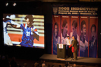 Hall of Fame inductee Fernando Clavijo receives his jacket and certificate from hall President and CEO Will Lunn as career highlights are projected on a screen at the National Soccer Hall of Fame induction ceremony. Wright Soccer Campus, Oneonta, NY, on August  29, 2005.