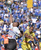 BOGOTA - COLOMBIA -27 -09-2015: Carlos Abella, arquero del Atlético Huila en acción durante el encuentro entre Millonarios y Atlético Huila por la fecha 14 de la Liga Águila II 2015 jugado en el estadio Nemesio Camacho El Campín de la ciudad de Bogotá./ Carlos Abella goalkeeper of Atletico Huila in action during the match between Millonarios and Atletico Huila for the date 14 of the Aguila League II 2015 played at Nemesio Camacho El Campin stadium in Bogota city. Photo: VizzorImage / Gabriel Aponte / Staff.