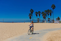 Girl on a bike In Venice Beach, Los Angeles, California