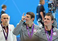 August 02, 2012..Laszlo Cseh, Michael Phelps, Ryan Lochte walk around the pool at the conclusion of Men's 200m Individual Medley Award Ceremony at the Aquatics Center on day six of 2012 Olympic Games in London, United Kingdom.