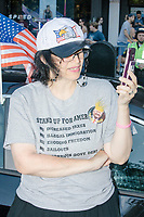 A woman wearing a Trump 2020 pin and patriotic shirt and t-shirt takes part in the Straight Pride Parade in Boston, Massachusetts, on Sat., August 31, 2019.
