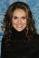 """HOLLYWOOD, CA - NOVEMBER 19: Amy Brenneman at the World Premiere Of Walt Disney Animation Studios' """"Frozen"""" held at the El Capitan Theatre on November 19, 2013 in Hollywood, California. (Photo by David Acosta/Celebrity Monitor)"""