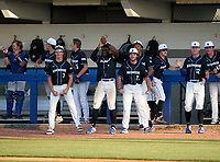 IMG Academy Ascenders bench (L-R) Brady Neal (catcher), Max Galvin (17), Evan Clark (7), Drew Gray (15), Elijah Green (2), Mason Albright (11), Davion Hickson (6), Joseph Slattery (22), Blaydon Plain (12), and Aeden Finateri (40) celebrate during a game against the Jesuit Tigers on April 21, 2021 at IMG Academy in Bradenton, Florida.  (Mike Janes/Four Seam Images)