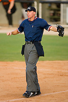 Home plate umpire Chris Graham indicates the ball was foul during a South Atlantic League game between the Delmarva Shorebirds and the Kannapolis Intimidators at Fieldcrest Cannon Stadium July 6, 2009 in Kannapolis, North Carolina. (Photo by Brian Westerholt / Four Seam Images)