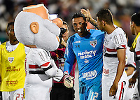 Orlando, FL - Saturday Jan. 21, 2017: São Paulo goalkeeper Sidão (12) is congratulated by São Paulo defender Lucão (4) and the mascot after he makes two saves during the 4-3 penalty shootout victory during the Florida Cup Championship match between São Paulo and Corinthians at Bright House Networks Stadium. The game ended 0-0 in regulation with São Paulo defeating Corinthians 4-3 on penalty kicks