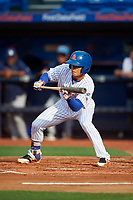 St. Lucie Mets shortstop Andres Gimenez (12) squares around to bunt during the first game of a doubleheader against the Charlotte Stone Crabs on April 24, 2018 at First Data Field in Port St. Lucie, Florida.  St. Lucie defeated Charlotte 5-3.  (Mike Janes/Four Seam Images)