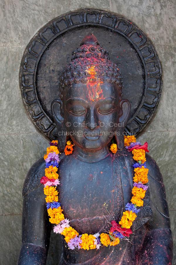 Kathmandu, Nepal.  Buddha Statue with Flower Garland.
